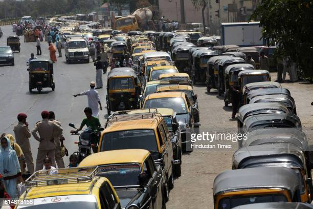 Auto and Taxi drivers wait out side the Gas station to fill the CNG gas at BKC CNG Gas stations in Mumbai run out of the gas due to the leakage in...