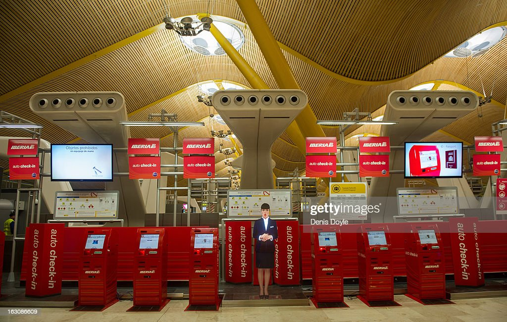 Auto check-in machines stand idle at Barajas Airport on March 4, 2013 in Madrid, Spain. Iberia workers have begun the second round of five day strikes in protest at plans by British based holding company IAG (International Consolidated Airlines Group), formed by the 2011 merger of Iberia and British Airways, to implement redundancies and pay cuts across the troubled Spanish airline. The strike is estimated to cause the cancelling of almost 1,300 flights this week, with a final round of five day strikes planned for March 18 to 22.
