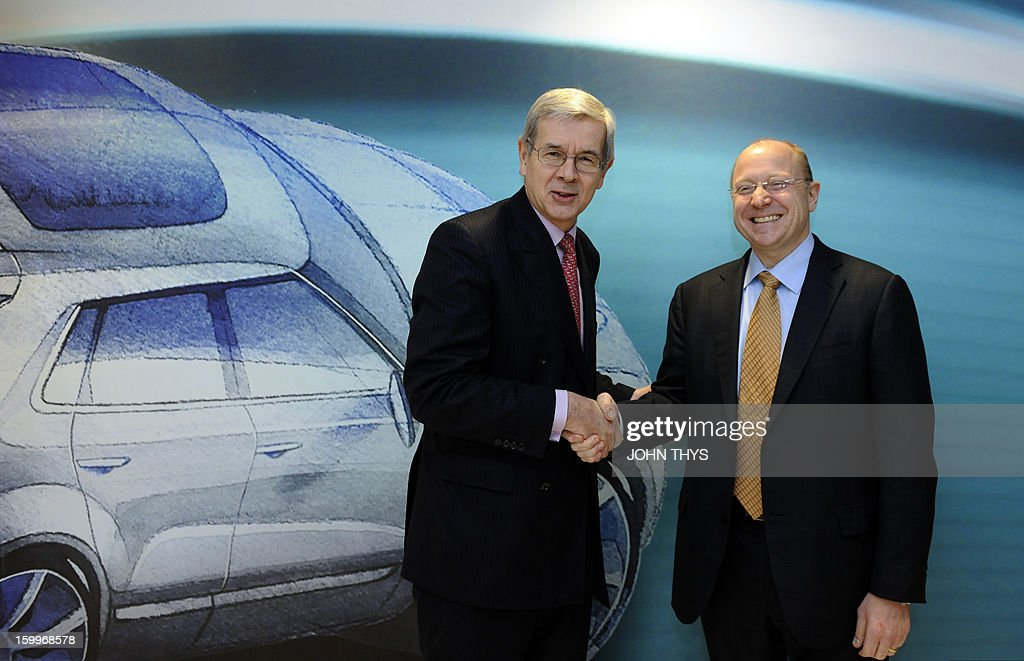 US auto giant General Motors vice chairman and Opel supervisory board chief Stephen Girsky (R) shakes hands with the board chairman of French carmaker PSA Peugeot Citroen, Philippe Varin, on January 24, 2013 before giving a press conference in Brussels. GM and PSA said the French carmaker would take the lead in developing joint models as the first anniversary approaches of an alliance aimed at restoring profit to European operation. Peugeot will spearhead work on the three vehicle platforms that both manufacturers will use for compact cars they plan to put on sale in 2016.
