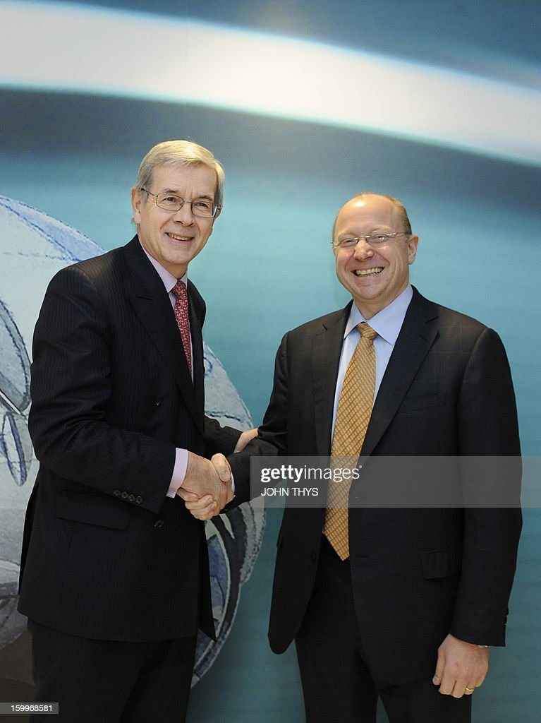 US auto giant General Motors vice chairman and Opel supervisory board chief Stephen Girsky (R) shakes hands with the board chairman of French carmaker PSA Peugeot Citroen, Philippe Varin, on January 24, 2013 before giving a press conference in Brussels. GM and PSA said the French carmaker would take the lead in developing joint models as the first anniversary approaches of an alliance aimed at restoring profit to European operation. Peugeot will spearhead work on the three vehicle platforms that both manufacturers will use for compact cars they plan to put on sale in 2016. AFP PHOTO / JOHN THYS