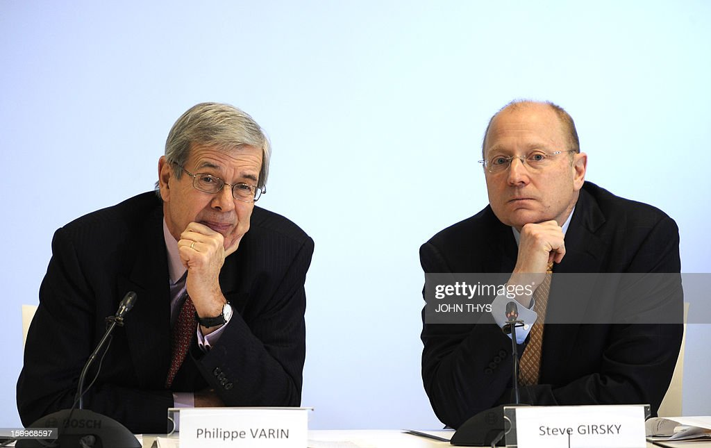 US auto giant General Motors vice chairman and Opel supervisory board chief Stephen Girsky (R) and board chairman of French carmaker PSA Peugeot Citroen, Philippe Varin, give a press conference on January 24, 2013 in Brussels. GM and PSA said the French carmaker would take the lead in developing joint models as the first anniversary approaches of an alliance aimed at restoring profit to European operation. Peugeot will spearhead work on the three vehicle platforms that both manufacturers will use for compact cars they plan to put on sale in 2016.