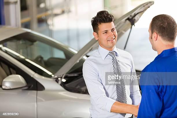 Auto Mechanic and Customer