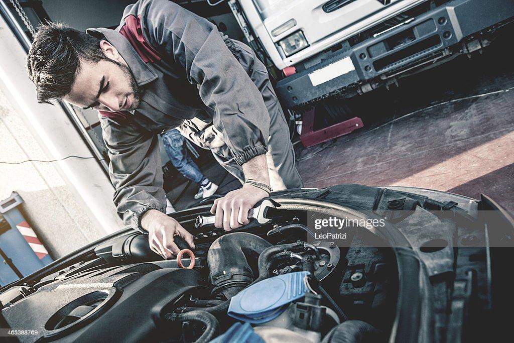Auto mechanic fixing a car engine