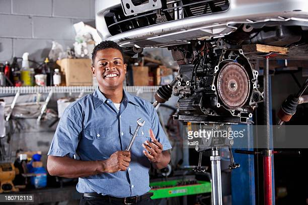 Auto mechanic fixing car transmission