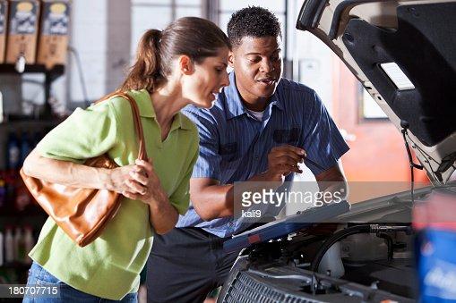Auto mechanic with customer