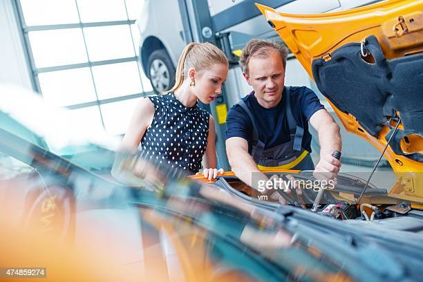 Auto Mechanic with Female Customer