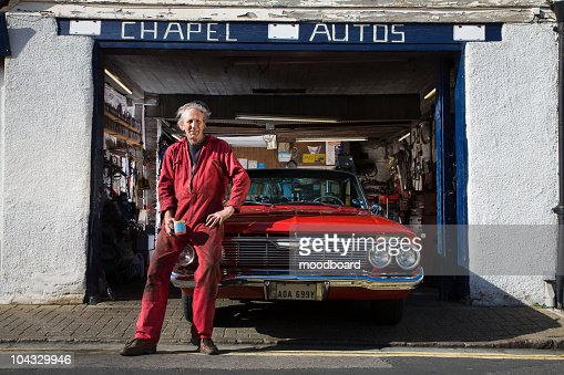 Auto Mechanic with Restored 1961 Chevrolet Impala