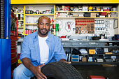 Auto Mechanic Working on a Tire