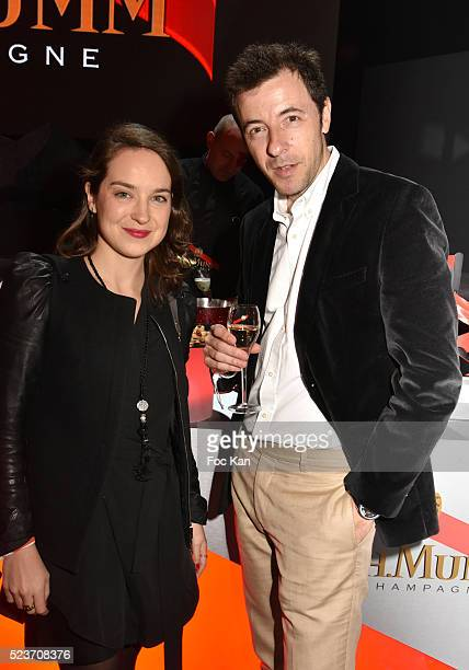 Auto Moto journalist Marion Jolles and Foumule E pilote Sebastien Grosjean attend Mumm Grand Cordon Champagne Launch Party At The YoYo Club on April...