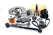 Auto parts background. Hub, pump, brake pads, filter, timing belt, rollers, constant velocity joints, thermostat and other on white background. Set of spare parts for repair