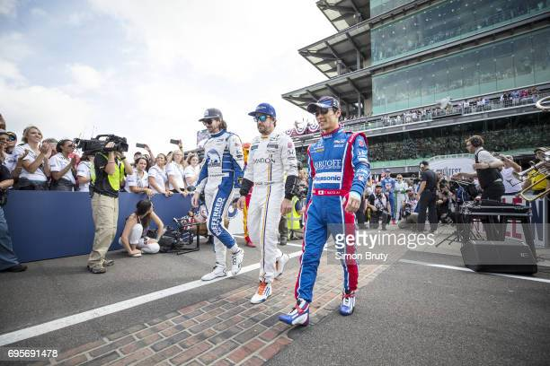 101st Indianapolis 500 JR Hildebrand Fernando Alonso and Takuma Sato approach their cars before race at Indianapolis Motor Speedway Verizon IndyCar...