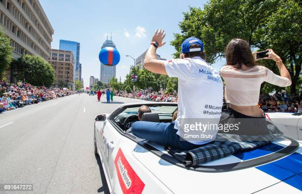 101st Indianapolis 500 Preview Rear view of Fernando Alonso with girlfriend Linda Morselli seated on car during parade before practice session at...