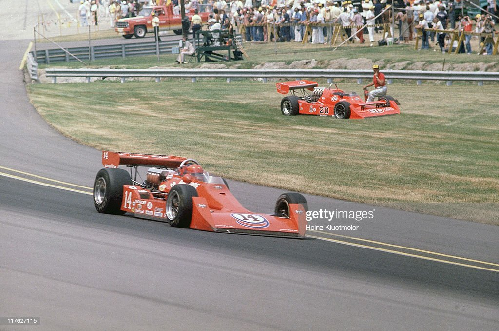 A.J. Foyt (14) in action, passing Gordon Johncock (20) during race at Indianapolis Motor Speedway. Johncock with blown engine while battling for lead late in race. Heinz Kluetmeier F31 )