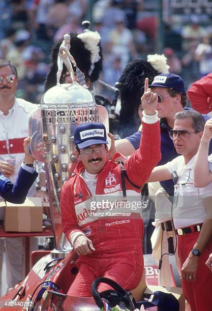 Indianapolis 500 Bobby Rahal victorious in Victory Lane with BorgWarner Trophy after winning race at Indianapolis Motor Speedway Indianapolis IN...