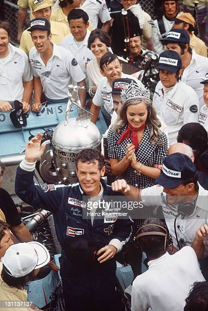 Indianapolis 500 Bobby Unser victorious holding milk during Victory Lane celebration after winning race at Indianapolis Motor Speedway View of...