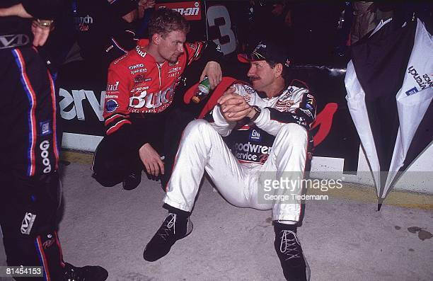 Auto Racing NASCAR Coca Cola 600 Closeup of Dale Earnhardt Sr and Dale Earnhardt Jr Charlotte NC 5/28/2000