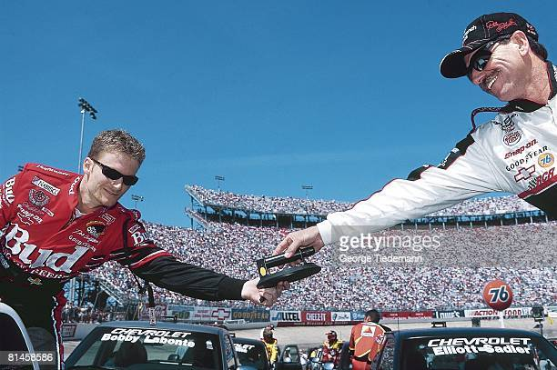 Auto Racing NASCAR Food City 500 Closeup of Dale Earnhardt Sr and Dale Earnhardt Jr during driver introductions before race Bristol TN 3/26/2000