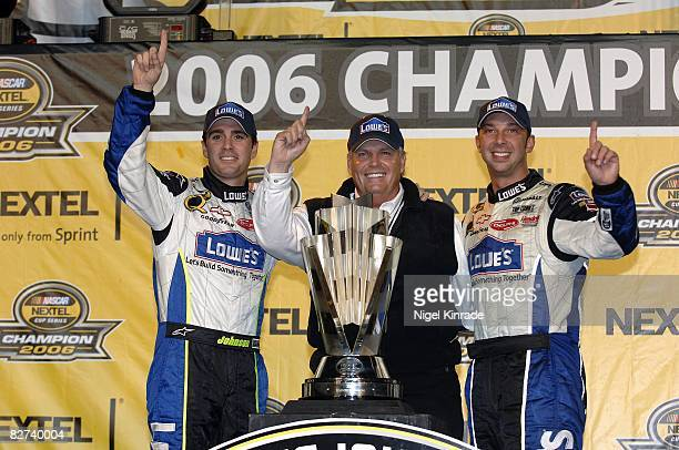 NASCAR Ford 400 Jimmie Johnson #48 car owner Rick Hendrick and crew chief Chad Knaus victorious with trophy during celebration on victory lane after...