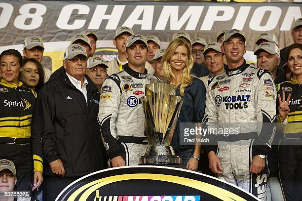 NASCAR Ford 400 Jimmie Johnson victorious with owner Rick Hendrick wife Chandra Johnson and crew chief Chad Knaus during celebration on Victory Lane...