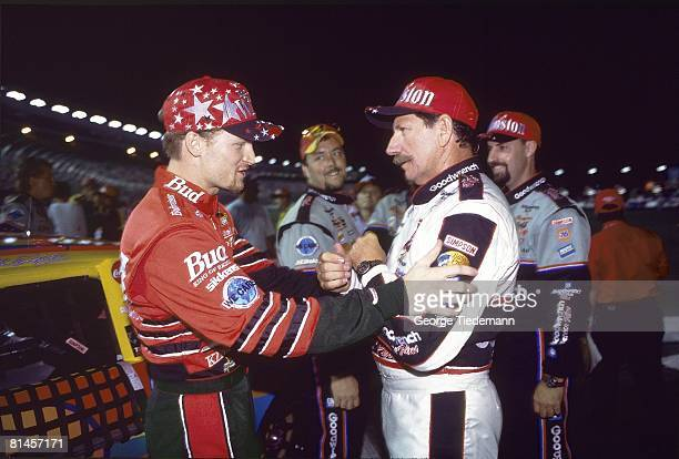 Auto Racing NASCAR Winston All Star race Closeup of Dale Earnhardt Sr and Dale Earnhardt Jr before race Concord NC 5/20/2000