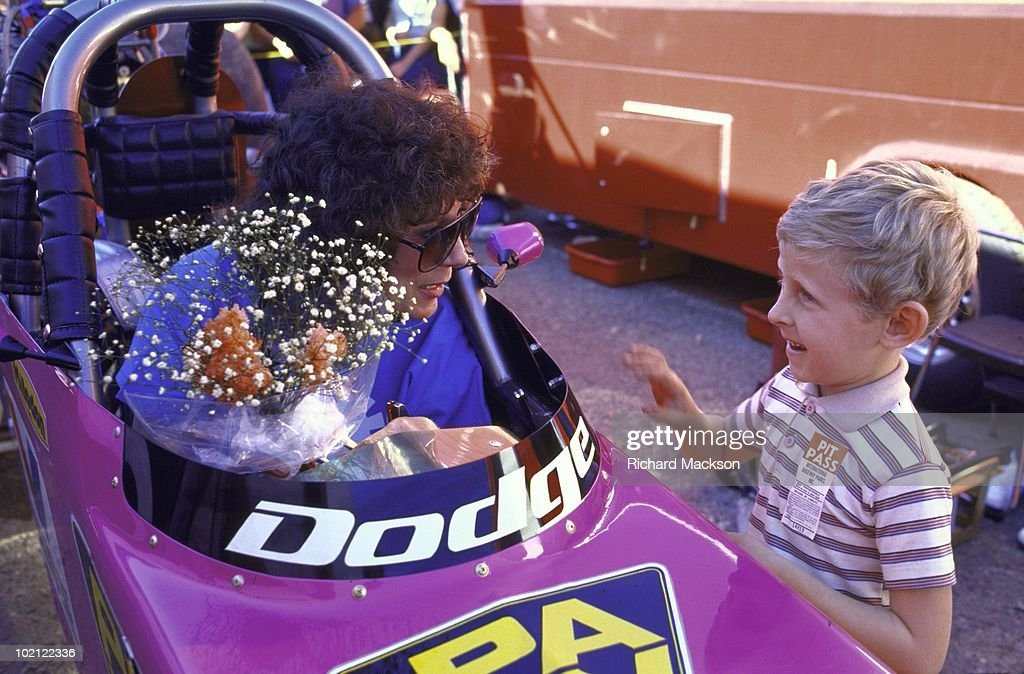 Shirley Muldowney receiving flowers from youth after Top Fuel race at Firebird International Raceway. Super Bowl of Drag Racing. NHRA Winston Drag Racing Series. Pomona, CA 1/17/1986