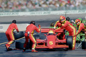 Auto racing pit crew working on car at pit stop during race