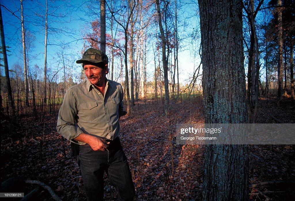 Portrait Dale Earnhardt near tree. Mooresville, NC