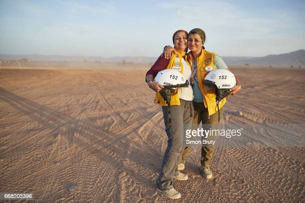 Rallye Aicha des Gazelles Portrait of Asma Chakroun and Amal Morse posing victorious after completing race Over 300 women from around the world...