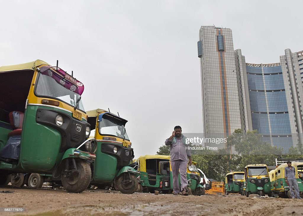 Auto rickshaws parked at Ramlila Maidan during the auto taxi strike on July 27 2016 in New Delhi India The capital's auto and taxi unions went on...