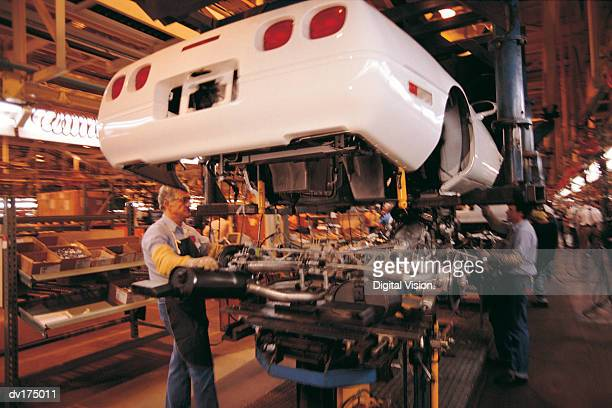 Auto workers on assembly line