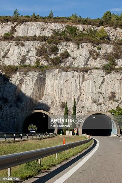 Autobahn leading towards mountain tunnel