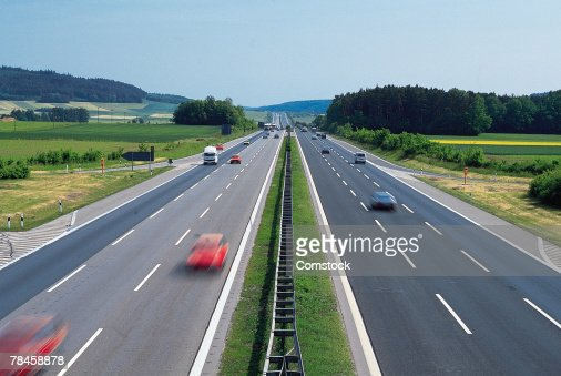 Autobahn with fast moving cars