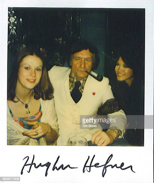Autographed polaroid photograph of American businessman and Playboy founder Hugh Hefner as he poses with his daughter Christie Hefner and girlfriend...