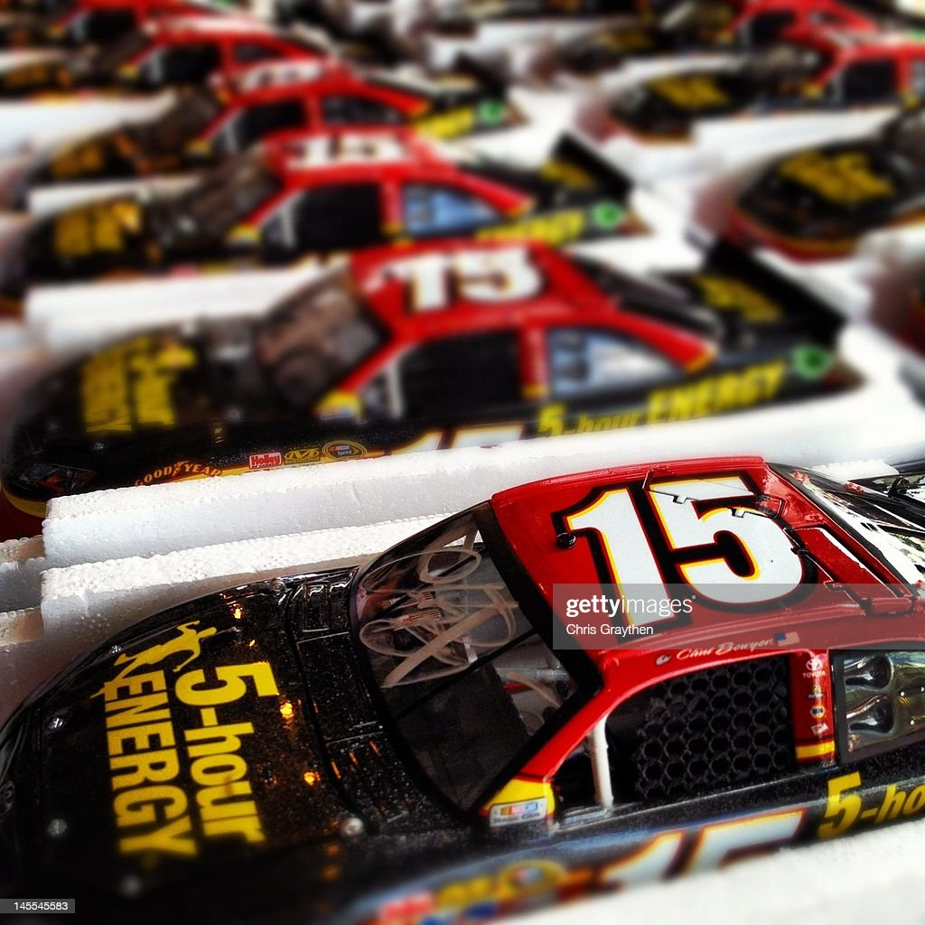 Autographed toy cars for Clint Bowyer, driver of the #15 5-hour Energy Toyota, are seen prior to the NASCAR Sprint Cup Series Coca-Cola 600 at Charlotte Motor Speedway on May 27, 2012 in Concord, North Carolina.