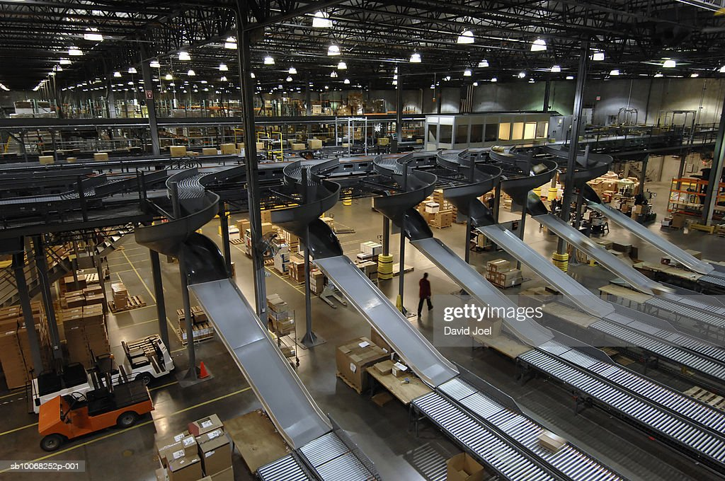 Automated chutes and conveyors in warehouse : Stock Photo