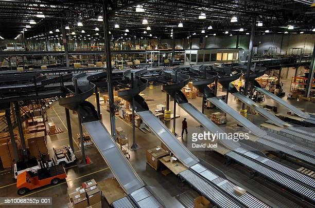 Automated chutes and conveyors in warehouse