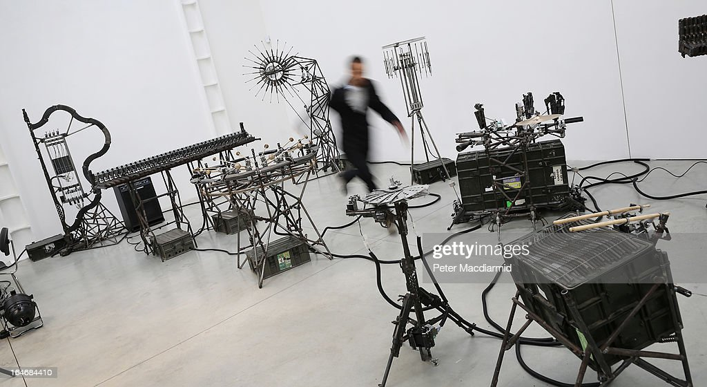 Automated musical instruments made from recycled gun parts are shown at Pedro Reyes' exhibition at the Lisson Gallery on March 26, 2013 in London, England. Mexican artist Pedro Reyes received 6,700 destroyed weapons from the Mexican government from which he sculpted two groups of instruments. The first, a series titled Imagine, is an orchestra of fifty instruments, from flutes to string and percussion instruments, designed to be played live. The second, Disarm, is an installation of mechanical musical instruments, which can either be automated or played live by an individual operator using a laptop computer or midi keyboard.
