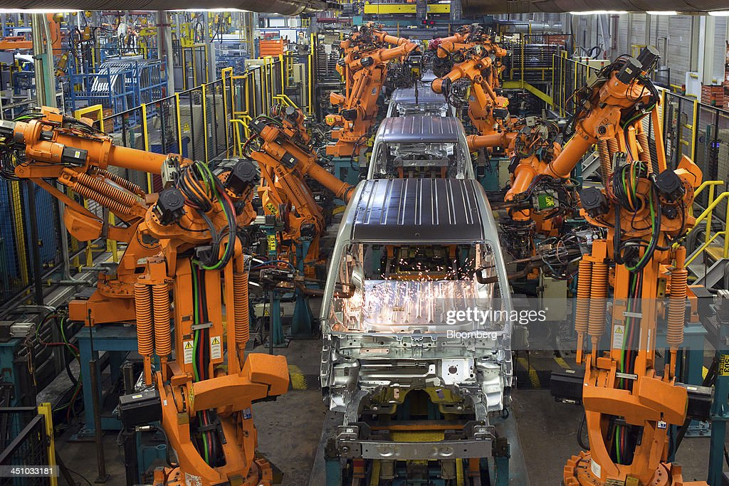 Automated robots weld joints on the shells of a Ford Connect vans as they travel along the production line at the Ford Otosan plant, the joint venture between Ford Motor Co.'s Ford Otomotiv Sanayi AS and Koc Holding AS, in Golcuk, Turkey, on Wednesday, Nov. 20, 2013. Istanbul-based Automobile Distributors' Association, or ODD, forecasts Turkey's total automotive industry market to be between 830k and 870k this year. Photographer: Kerem Uzel/Bloomberg via Getty Images