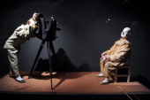 Automated toys of a photographer and a clown are on display at the Automaton museum in Souillac on July 10 2013 AFP PHOTO/ERIC CABANIS