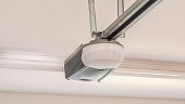 Automatic Garage Door Opener Motor on the Ceiling. Close Up