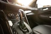 Automatic gear stick of a modern car. Car interior details