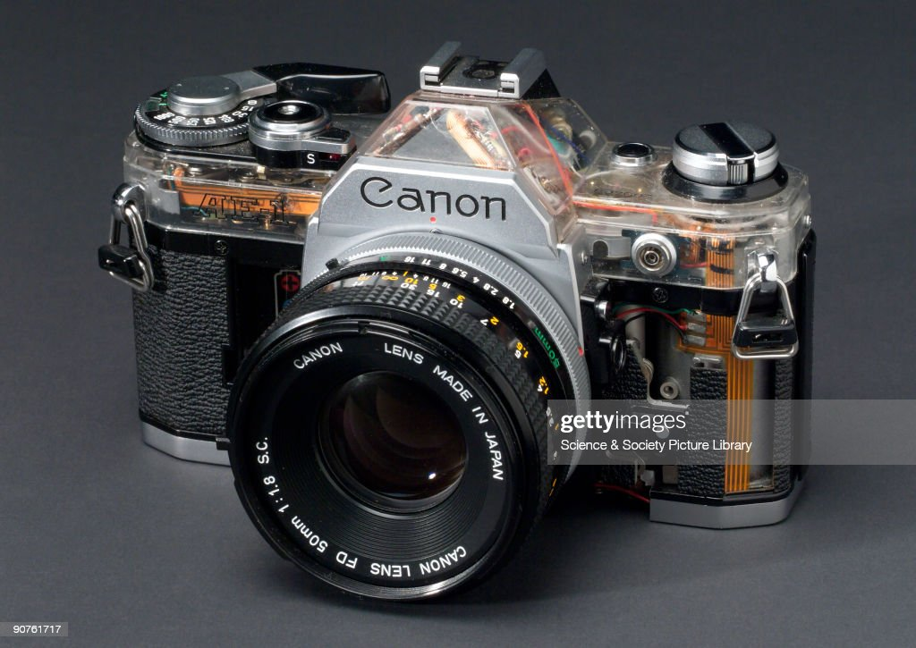Automatic single lens reflex 35mm camera made by Canon partically cut away to show internal construction