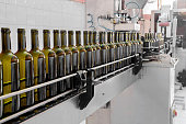wine bottles filled with wine by an industrial machine in a wine factory