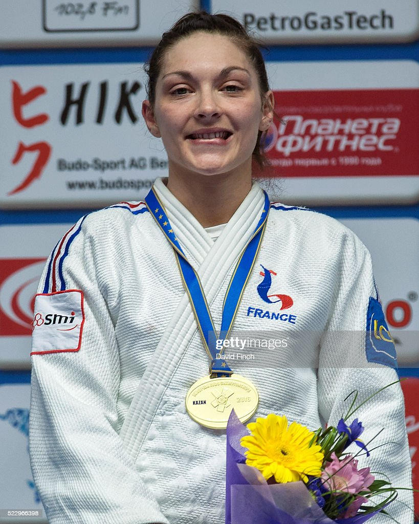Automne Pavia of France bites her lip and smiles after receiving the u57kg gold medal during the 2016 Kazan European Judo Championships April 21, 2016 at the Tatneft Sports Palace in Kazan, Russia.