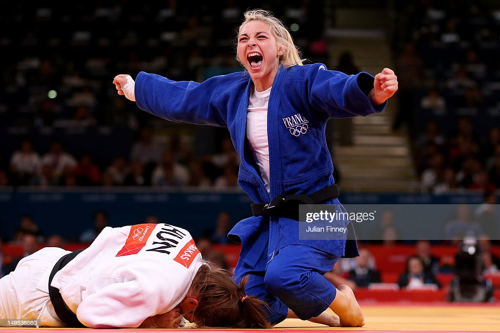 Automne Pavia of France celebrates her bronze medal B over Hedvig Karakas of Hungary during the Women's -57 kg Judo on Day 3 of the London 2012 Olympic Games at ExCeL on July 30, 2012 in London, England.