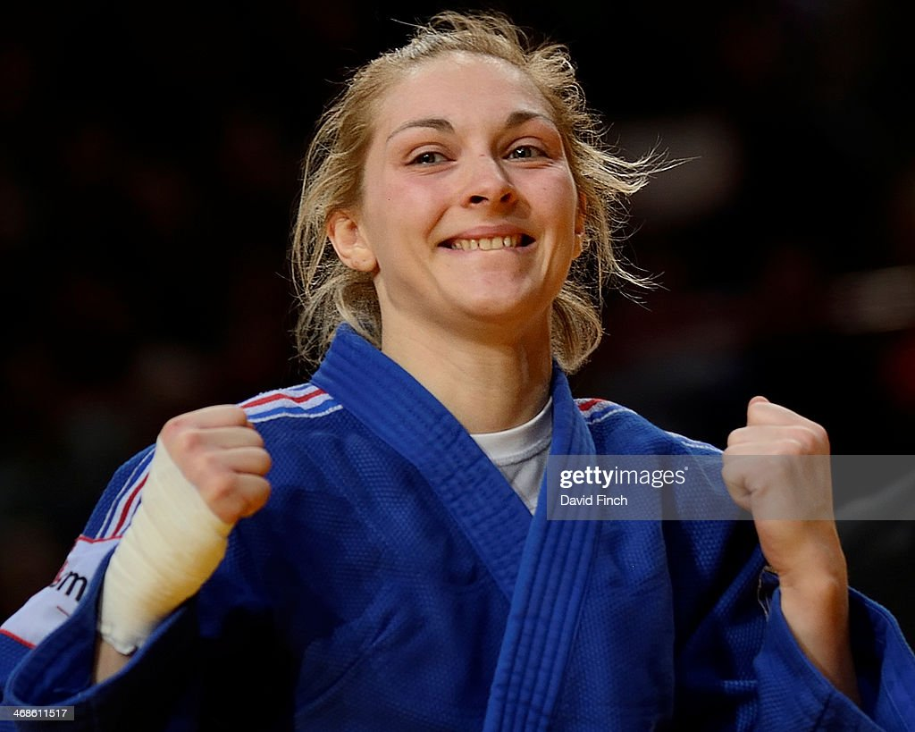 Automne Pavia of France reacts with joy after throwing former European champion, Sabrina Filzmoser of Austria for ippon to win the u57kg bronze medal during the Paris Grand Slam on day 2, Saturday, February 08, 2014 at the Palais Omnisports de Paris, Bercy, Paris, France.
