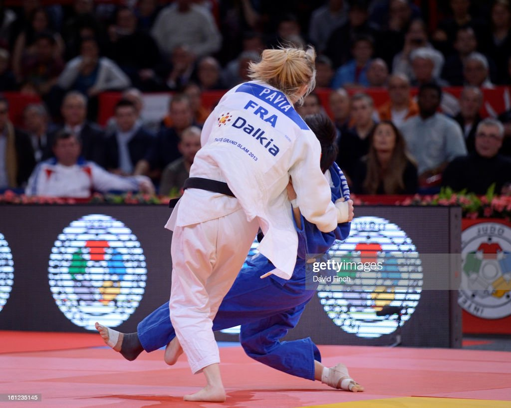 Automne Pavia of France (white) sweeps the legs from under Anzu Yamamoto of Japan to score ippon (10 points) and win the u57kgs final during the Paris Grand Slam on day 1 February 09, 2013 at the Palais Omnisports de Paris, Bercy, Paris, France.
