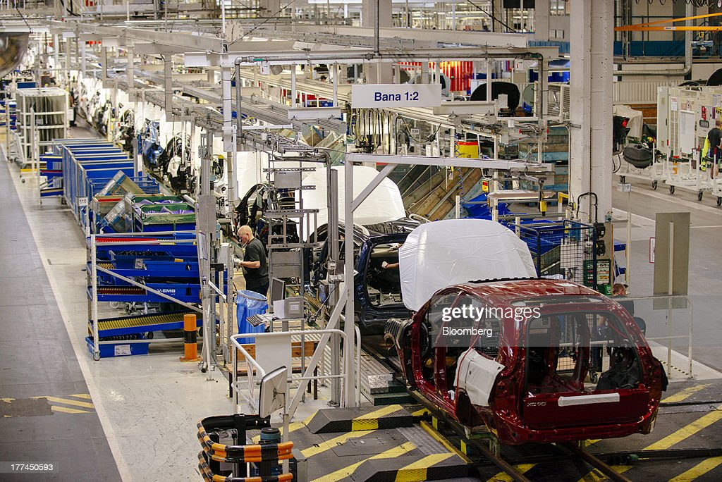 Automobile chassis move along on the production line during the early stages of assembly at the Volvo Cars plant in Torslanda, Sweden, on Thursday, Aug. 22, 2013. Volvo Cars Chief Executive Officer Hakan Samuelsson will settle a German investigation into corruption allegations linked to his tenure as MAN SE's CEO by paying 500,000 euros ($668,000) to charity. Photographer: Kristian Helgesen/Bloomberg via Getty Images