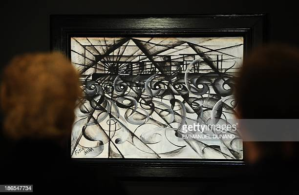 'Automobile in Corsa' by artist Giacomo Balla is on display during a press preview of Sotheby's auction of impressionist and modern art at Sotheby's...