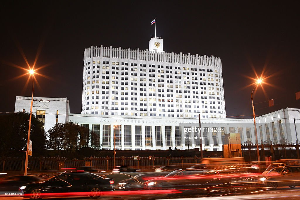 Automobile light trails pass the Russian White House government building in Moscow, Russia, on Thursday, Oct. 10, 2013. Tinkoff Credit Systems Bank, operated by TCS Group Holding Plc, is valued at $2.5b to $3b for London IPO, which reflects P/E multiple of 9.5 to 11.4, Vedomosti reports, citing unidentified people familiar with offering documents. Photographer: Andrey Rudakov/Bloomberg via Getty Images